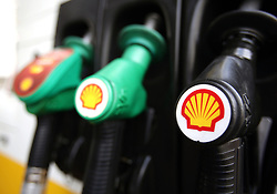 File photo dated 08/04/15 of Shell logos on petrol pumps at a petrol station. Royal Dutch Shell has been rapped over its climate change commitments, with shareholders criticising its rejection of emissions targets that would bring it in line with the Paris climate accord.