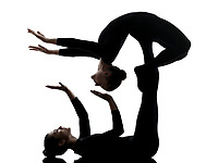 two women contortionist practicing gymnastic yoga in silhouette on white background