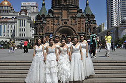 June 8, 2017 - Harbin, China - Chinese college graduates wearing wedding dress at St. Sophia Cathedral in Harbin as they take their group graduation photograph at Harbin of China. The number of Chinese college graduates hit a historical high record reaching 7.95 million in 2017. (Credit Image: © Tao Zhang/NurPhoto via ZUMA Press)