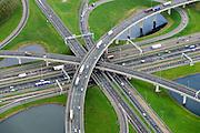 Nederland, Zuid-Holland, Gemeente Rotterdam, 23-10-2013; Knooppunt Ridderkerk, verkeersknooppunt A15 en A16, bijgenaamd 'Ridderster'. Klaverblad met opritten, afritten en fly-overs. De waterpartijen zijn kunstmatige aangelegd en kunnen dienen als bluswater ingeval van calamiteiten.<br /> Ridderkerk junction, junction A15 / A16, nicknamed 'Ridder star'. Cloverleaf type junction, with ramps, exit ramps and flyovers. The ponds are man-made, the water can be used for firefighting in case of emergencies.<br /> luchtfoto (toeslag op standard tarieven);<br /> aerial photo (additional fee required);<br /> copyright foto/photo Siebe Swart