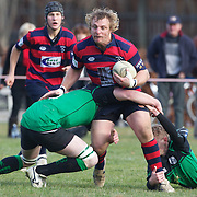Aidan Winter of Arrowtown is tackled during the Arrowtown V Alexandra Rugby match at Jack Reid Park, Arrowtown, South Island, New Zealand, 25th June 2011
