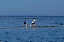 Boys Playing On Sandbar
