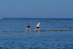 Boys Playing On Sandbar