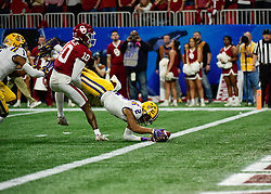 LSU Tigers wide receiver Justin Jefferson (2) scores  during the first half against as Oklahoma Sooners safety Pat Fields (10) tres to keep him out of the end zone in the 2019 College Football Playoff Semifinal at the Chick-fil-A Peach Bowl on Saturday, Dec. 28, in Atlanta. (Vasha Hunt via Abell Images for the Chick-fil-A Peach Bowl)
