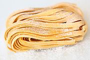 Linguine egg pasta on white background