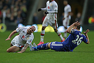 John Terry, the Chelsea captain fouls Samir Carruthers of MK Dons. The Emirates FA cup, 4th round match, MK Dons v Chelsea at the Stadium MK in Milton Keynes on Sunday 31st January 2016.<br /> pic by John Patrick Fletcher, Andrew Orchard sports photography.