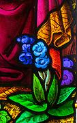 Detail of flower stained glass window, 1866 H Hughes, Brettenham church, Suffolk, England, UK