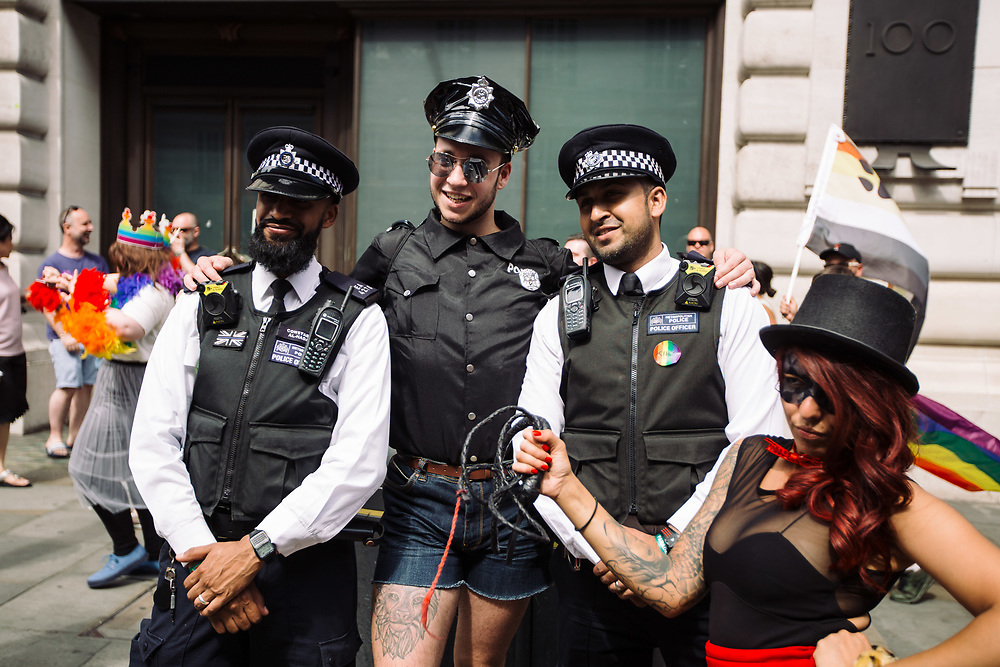 Revellers take part in the Pride in London Parade, the Lesbian, Gay, Bisexual, and Transgender (LGBT) community parade in central London, England, on July 8, 2017. The annual event attracts hundreds of thousands of people who take to the streets in celebration and support of the LBGT+ community, making this the city's biggest one-day event and one of the world's biggest LGBT+ celebrations. This year's London Pride event marks 50 years since homosexuality was decriminalised in England and Wales under the 1967 Sexual Offences Act.