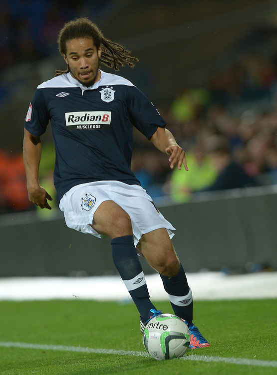 Huddersfield Town's Sean Scannell in action during todays match  ..Football - npower Football League Championship - Cardiff City v Huddersfield Town - Friday 17th August 2012 - Cardiff City Stadium - Cardiff..