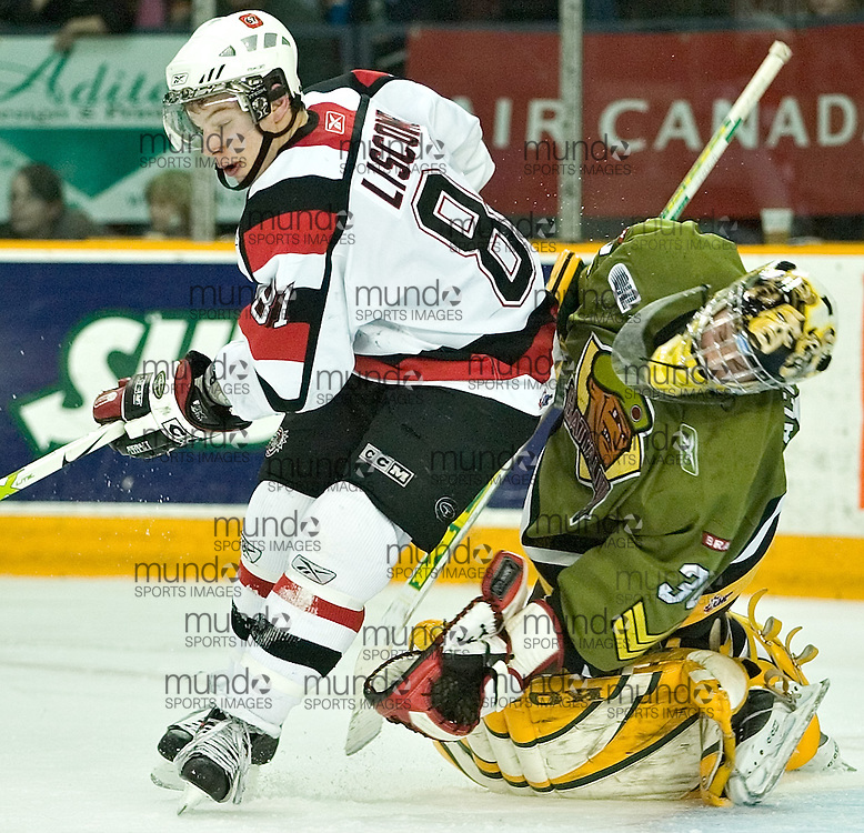 Ottawa, Ontario ---06/3/10--- Ottawa's Brett Liscomb collides with Brampton goaltender Daren Machesney during the second period as the 67's took on the Battalion at the Civic Centre Friday night. There was no penalty on the play..GEOFF ROBINS The Ottawa Sun<br />