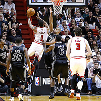 29 January 2012: Chicago Bulls point guard Derrick Rose (1) goes for the layup against Miami Heat small forward Shane Battier (31) during the Miami Heat 97-93 victory over the Chicago Bulls at the AmericanAirlines Arena, Miami, Florida, USA.