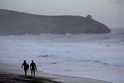 © Licensed to London News Pictures. 12/12/2020. Penzance, UK. Surfers at sunset at Praa Sands beach in Cornwall. Photo credit : Tom Nicholson/LNP