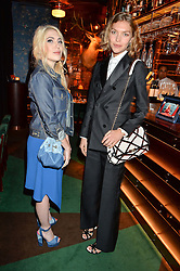 Left to right, CAMILLE SEYDOUX and ARIZONA MUSE at a dinner hosted by Roger Vivier to celebrate The Prismick Denim by Camillle Seydoux held at Casa Cruz, 123 Clarendon Road, London on 17th March 2016.