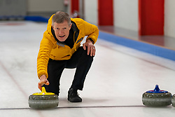 Edinburgh, Scotland, UK. 29th November 2019. Scottish Liberal Democrat Leader Willie Rennie was joined by Liberal Democrat MP candidates to launch the party's General Election manifesto at the Edinburgh Curling Rink. Pictured; Willie Rennie tries curling. Iain Masterton/Alamy Live News.
