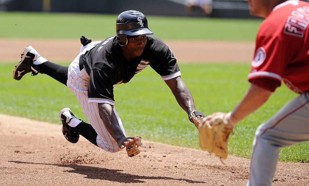 CHICAGO - JULY 08:  Juan Pierre #1 of the Chicago White Sox slides safely into third base in the first inning against the Los Angeles Angels of Anaheim on July 8, 2010 at U.S. Cellular Field in Chicago, Illinois.  Pierre eventually scored the only run of the game on a sacrifice fly hit by Paul Konerko #14 of the Chicago White Sox.  The White Sox defeated the Angels 1-0.  (Photo by Ron Vesely)