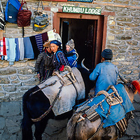 Sherpas prepare to carry loads for trekkers at a lodge in Namche Bazar in the Khumbu region of Nepal 1986.