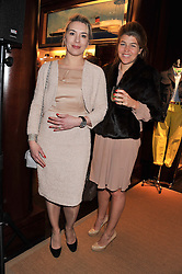 Left to right, CECILIA ZOPPELLETTO and AMBER NUTTALL at a shopping evening hosted by Kola Karim to celebrate the sport of polo with leading polo player Nacho Figueras at Ralph Lauren, 1 New Bond Street, London on 16th May 2013.