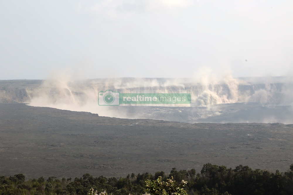 July 25, 2018 - Hawaii, U.S. - Earthquakes shook the ground at Kilauea's summit late this afternoon, stirring up rock dust within Halemaumau and along the caldera walls. This view from the northeast caldera rim looks across at the Keanakako'i and South Sulphur Banks areas. (Credit Image: ? USGS/ZUMA Wire/ZUMAPRESS.com)