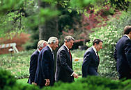 President Ronald Reagan with Secretary of the Treasury Donald Regan and Secretary of Defense Casper Weinberger walking back to the Oval Office on April 14, 1986<br />Photo by Dennis Brack
