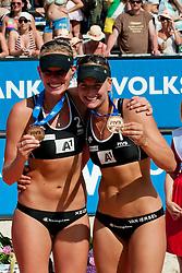 06-08-2011 VOLLEYBAL: FIVB WORLD TOUR GRANDSLAM: KLAGENFURT<br /> Third place for Marleen Van Iersel and Sanne Keizer of Netherland<br /> ©2011-FotoHoogendoorn.nl / Matic Klansek Velej