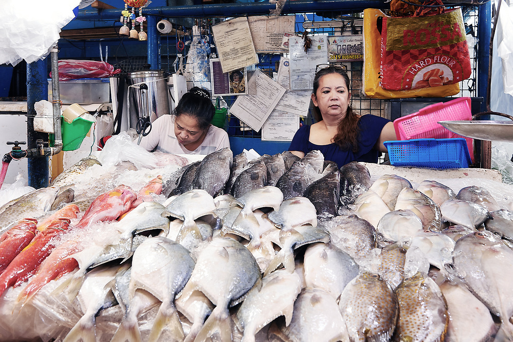 Photography of products, people and stores at the wet markets of Manilla in the Phillipines.