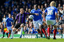 David Clarkson (SCO) of Bristol Rovers is challenged by Bondz Ngala (ENG) of Portsmouth - Photo mandatory by-line: Rogan Thomson/JMP - 07966 386802 - 19/04/2014 - SPORT - FOOTBALL - Fratton Park, Portsmouth - Portsmouth FC v Bristol Rovers - Sky Bet Football League 2.