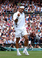 Roger Federer (Switzerland) celebrates winning the 2nd Set during his Semi-Final victory over Andy Roddick (USA) Wimbledon Tennis Championship, Day 11, 4/07/2003. Credit: Colorsport / Matthew Impey DIGITAL FILE ONLY