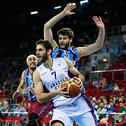 Anadolu Efes's Stratos Perperoglou (F) and Trabzonspor's Kaloyan İvanov (B) during their Turkish Basketball League Play Off Semi Final round 2 match Anadolu Efes between Trabzonspor at Abdi Ipekci Arena in Istanbul Turkey on Friday 31 May 2015. Photo by Aykut AKICI/TURKPIX