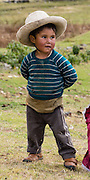 Cute campesino boy with hat at Pishgopampa village in Jancapampa Valley. Day 4 of 10 days trekking around Alpamayo, in Huascaran National Park, Cordillera Blanca, Andes Mountains, Peru, South America.