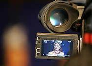 McAllen, TX - 13 Feb 2008 -.Senator Hillary Clinton, D-New York, is seen through the viewfinder of a TV camera during a press conference after a campaign rally on Wednesday morning at the McAllen Convention Center.