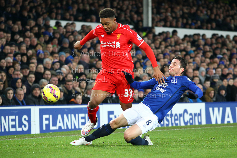 Bryan Oviedo of Everton tackles Jordon Ibe of Liverpool. Barclays Premier league match, Everton v Liverpool at Goodison Park in Liverpool, Merseyside on Saturday 7th February 2015<br /> pic by Chris Stading, Andrew Orchard sports photography.