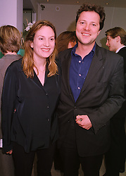 MISS EMILY OPPENHEIMER a member of the De Beers diamond family and MR WILLIAM TURNER, at a party in London on 21st April 1998.MGT 36
