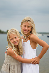 two beautiful little girls at the bay in East Hampton, NY hugging