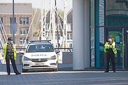 ©Licensed to London News Pictures 22/04/2020  <br /> Chatham, UK.  Police on guard outside the block of flats. A man has been arrested by armed police this morning in Chatham, Kent after wielding guns on a balcony at a Dockside flat. Photo credit:Grant Falvey/LNP