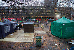 © Licensed to London News Pictures.02/02/2021, London,UK. Bailiffs work to evict a group of eco-activists which is living in increasingly unstable tunnels beneath the Euston Square Gardens in central London.The eviction of HS2 Rebellion group from the square began five days ago and continues today.  Photo credit: Marcin Nowak/LNP