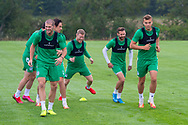 The Hibs players during the warm up before the training session at the Hibernian Training Centre, Ormiston, Scotland on 19 August 2020.