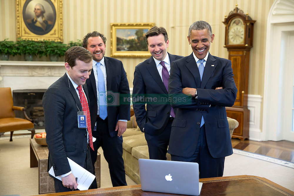 President Barack Obama laughs during speech prep for the White House Correspondents' Association Dinner with, from left, David Litt, Senior Presidential Speechwriter, Director of Speechwriting Cody Keenan and Press Secretary Josh Earnest in the Oval Office, April 23, 2015. (Official White House Photo by Pete Souza)<br /> <br /> This official White House photograph is being made available only for publication by news organizations and/or for personal use printing by the subject(s) of the photograph. The photograph may not be manipulated in any way and may not be used in commercial or political materials, advertisements, emails, products, promotions that in any way suggests approval or endorsement of the President, the First Family, or the White House.