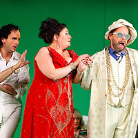 Picture shows : Thomas Walker as Lindoro, Karen Cargill as Isabella and Adrian Powter as Taddeo..Picture  ©  Drew Farrell Tel : 07721 -735041..A new Scottish Opera production of  Rossini's 'The Italian Girl in Algiers' opens at The Theatre Royal Glasgow on Wednesday 21st October 2009..(Soap) opera as you've never seen it before.Tonight on Algiers.....Colin McColl's cheeky take on Rossini's comic opera is a riot of bunny girls, beach balls, and small screen heroes with big screen egos. Set in a TV studio during the filming of popular Latino soap, Algiers, the show pits Rossini's typically playful and lyrical music against the shoreline shenanigans of cast and crew. You'd think the scandal would be confined to the outrageous storylines, but there's as much action off set as there is on.....Italian bass Tiziano Bracci makes his UK debut in the role of Mustafa. Scottish mezzo-soprano Karen Cargill, who the Guardian called a 'bright star' for her performance as Rosina in Scottish Opera's 2007 production of The Barber of Seville, sings Isabella..Cast .Mustafa...Tiziano Bracci.Isabella..Karen Cargill.Lindoro...Thomas Walker.Elvira...Mary O'Sullivan.Zulma...Julia Riley.Haly...Paul Carey Jones.Taddeo...Adrian Powter..Conductors.Wyn Davies.Derek Clarke (Nov 14)..Director by Colin McColl.Set and Lighting Designer by Tony Rabbit.Costume Designer by Nic Smillie..New co-production with New Zealand Opera.Production supported by.The Scottish Opera Syndicate.Sung in Italian with English supertitles..Performances.Theatre Royal, Glasgow - October 21, 25,29,31..Eden Court, Inverness - November 7. .His Majesty's Theatre, Aberdeen  - November 14..Festival Theatre,Edinburgh - November 21, 25, 27 ...Note to Editors:  This image is free to be used editorially in the promotion of Scottish Opera. Without prejudice ALL other licences without prior consent will be deemed a breach of copyright under the 1988. Copyright Design and Patents Act  and will be subject to payment or legal action, w