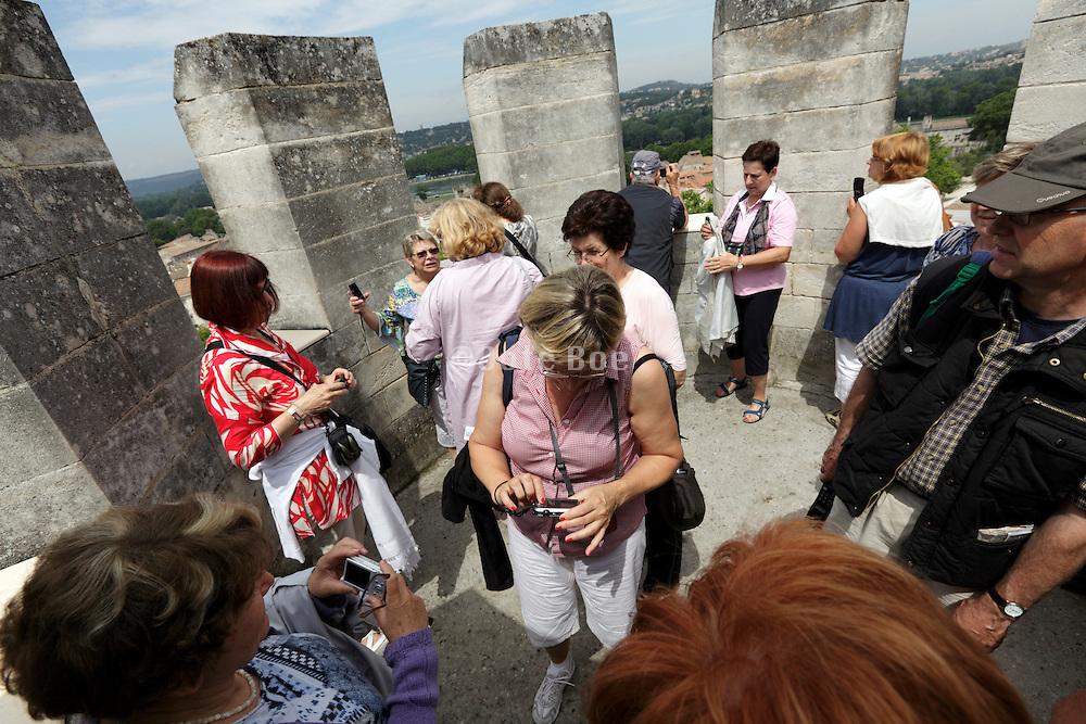 tourism on top the outlook tower of Le Palais des Papes Avignon