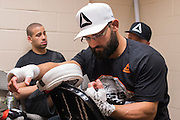 DALLAS, TX - MARCH 14:  Johny Hendricks has his hands wrapped backstage before his fight against Matt Brown during UFC 185 at the American Airlines Center on March 14, 2015 in Dallas, Texas. (Photo by Cooper Neill/Zuffa LLC/Zuffa LLC via Getty Images) *** Local Caption *** Johny Hendricks
