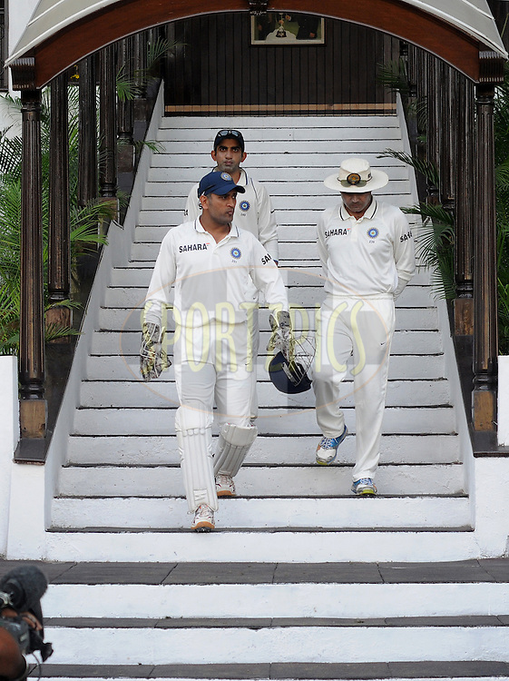 MS Dhoni captain of India (L), Virender Sehwag of India (R) and Gautam Gambhir of India walk down the stairs during day one of the 4th Airtel Test Match between India and England held at VCA ground in Nagpur on the 13th December 2012..Photo by  Pal Pillai/BCCI/SPORTZPICS .