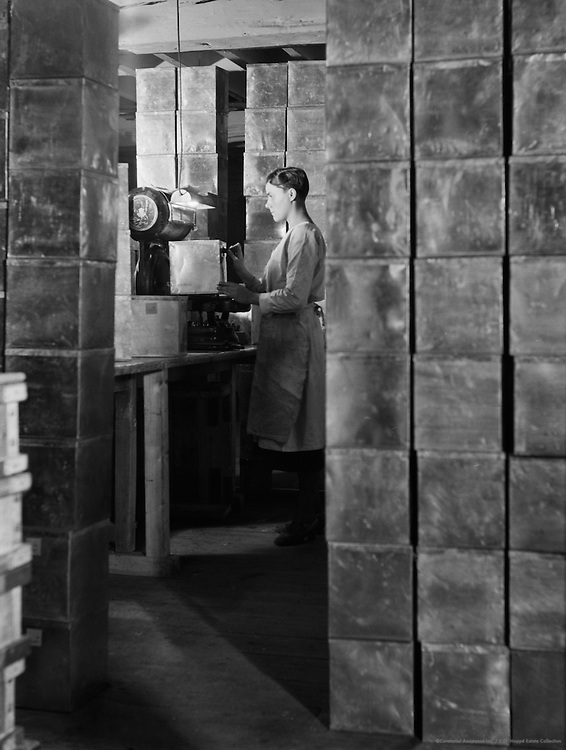 Worker and Boxes, Peek Frean Biscuit Company, England, circa 1932