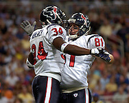 Houston tight end Owen Daniels (81) celebrates with running back Vernard Morency (34), after Morency's first half touchdown against the Rams at the Edward Jones Dome in St. Louis, Missouri, August 19, 2006.  Houston beat St. Louis 27-20.