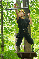 Town of Wallkill, New York - Makayla Stoltz leaps off a 23-foot-high platform to grab a trapeze bar during a Ninja Warrior Day Camp trip to Ring Homestead Camp on July 8, 2014.left, and Makayla Stoltz start to climb a ladder during a Ninja Warrior Day Camp trip to Ring Homestead Camp on July 8, 2014.
