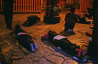 Pilgrims prostrate outside the Jokhang Temple, the most sacred site in Tibetan Buddhism.