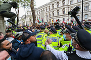London, United Kingdom, May 11, 2021: A man jumps over the police mounted cordon that was trying to pull out pro-Israeli protestors who gathered in Richmond Terrace to counter the Pro-Palestinian demonstrators outside Downing Street, central London on Tuesday, May 11, 2021. (Photo by Vudi Xhymshiti/VXP)