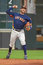 March 26, 2018 - Houston, TX, U.S. - HOUSTON, TX - MARCH 26: Houston Astros infielder Carlos Correa (1) makes a stop at shortstop and the play at first during the game between the Milwaukee Brewers and Houston Astros at Minute Maid Park on March 26, 2018 in Houston, Texas. (Photo by Ken Murray/Icon Sportswire) (Credit Image: © Ken Murray/Icon SMI via ZUMA Press)