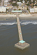 Aerial of the Folly Beach pier and on Folly Beach, South Carolina.