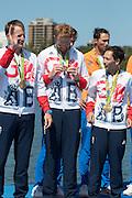 "Rio de Janeiro. BRAZIL. Will SATCH, checks out his medal. GBR W8+ Silver Medalist, awards dock. 2016 Olympic Rowing Regatta. Lagoa Stadium,<br /> Copacabana,  ""Olympic Summer Games""<br /> Rodrigo de Freitas Lagoon, Lagoa.   Saturday  13/08/2016 <br /> <br /> [Mandatory Credit; Peter SPURRIER/Intersport Images]"