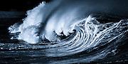 Photographic artwork of a powerful shorebreak wave at Waimea Bay on Oahu's north shore in Hawaii.